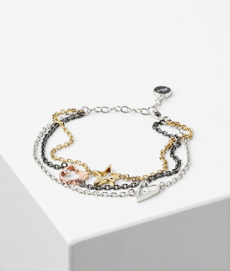 The Best Of Karl Lagerfeld's Design: The Most Supreme Jewerly Pieces karl lagerfeld The Best Of Karl Lagerfeld's Design: The Most Supreme Jewelry Pieces TRIPLE CHAIN CHARM BRACELET