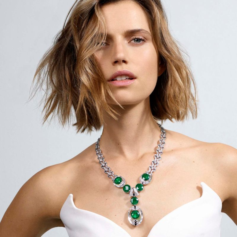 Magnitude Is The Cartier's Cosmic New High Jewelry Collection [object object] Cartier's Shows Exquisite Details In New Exclusive Jewellery Collection  cartier magnitude theia emerald necklace on model