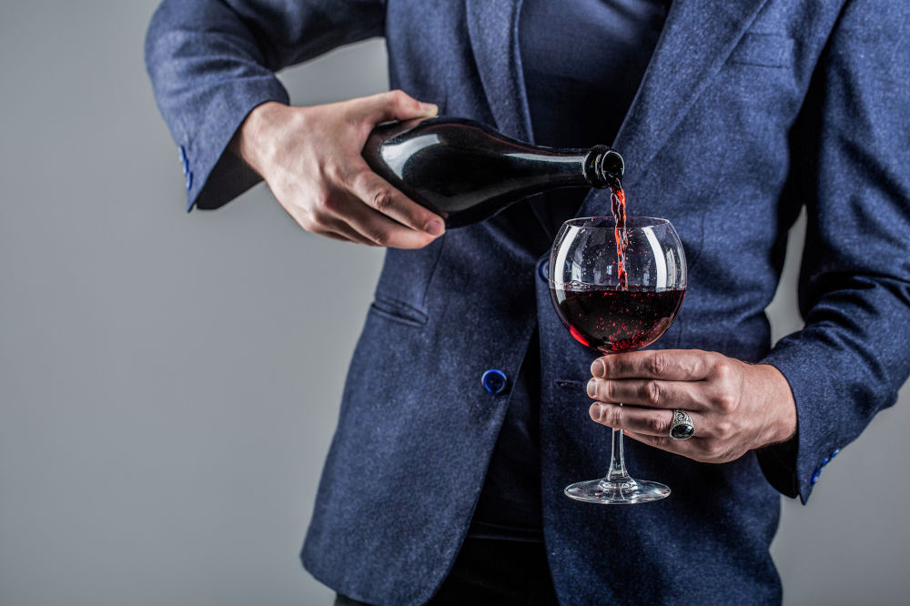 Wine Collection For A Luxury Lifestyle wine collection Wine Collection For A Luxury Lifestyle bigstock Red Wine Is Poured From Bottle 401192519